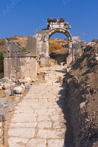 Ancient lycian ruins and the old stone road in Xanthos, Turkey.