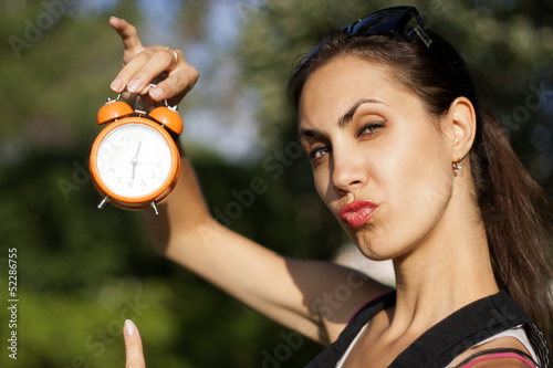 Young woman with clock