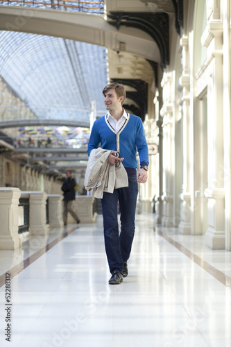 Young man walking in the store