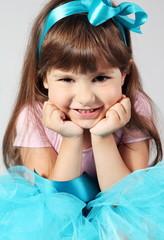 Little Smiling Girl Hands under Chin Portrait