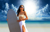 surfer girl with surfboard at a beach
