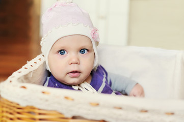 sweet blue-eyed baby in basket