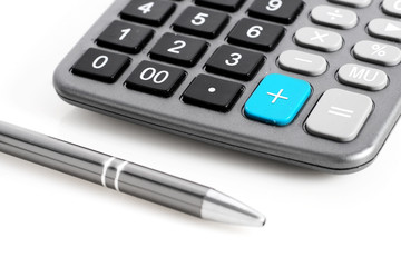 Calculator and pen.