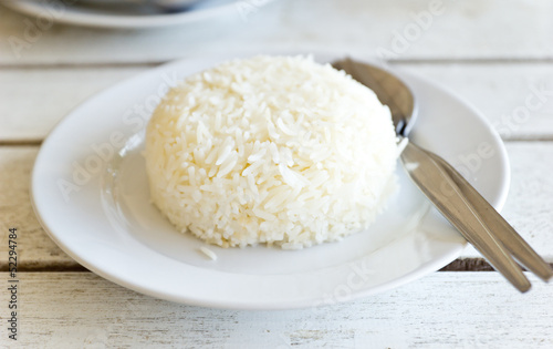 Thai jasmine cooked rice on white plate