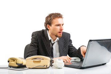 Businessman working at a computer intently