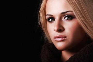 beautiful blond woman. black background
