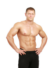 Healthy muscular young man. Isolated on white background