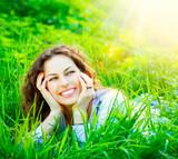 Fototapety Beautiful Young Woman Outdoors. Enjoy Nature