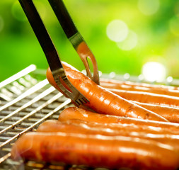 Grilled Sausage on the flaming Grill. BBQ. Bearbeque outdoors
