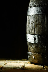 Old oak barrel on flagstones