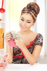 beautiful housewife with purse and money
