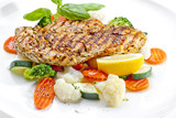 Tasty food. Grilled chicken breasts and vegetables . High qualit