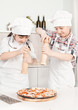 boy and girl chefs prepare pizza