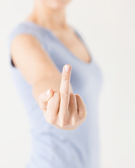 woman showing middle finger