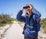 Man Hiking and Birdwatching, Looking Through Binoculars poster