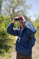 Man Hiking, Birdwatching and Looking Through Binoculars
