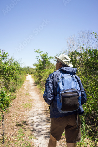 Man Hiking on a Path in a National Park