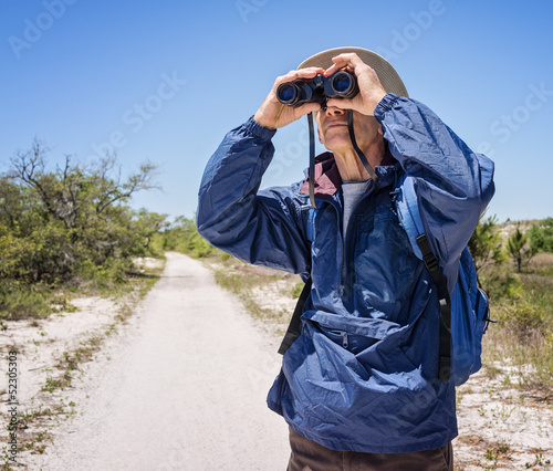 Man Hiking and Birdwatching, Looking Through Binoculars