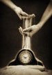 hands with sand and clock