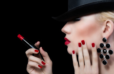 Beautiful young woman with red lips and manicure