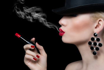 Beautiful girl with cigarette and red lips