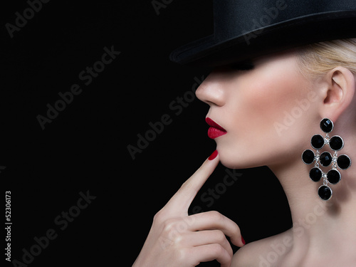 Beautiful girl with red lips and manicure