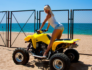 beautiful girl on a quad