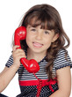 Adorable little girl wiht red phone