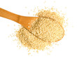 Big scoop of sesame seeds over a white background