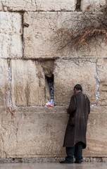 A poor man praying at the Wailing wall, Jerusalem, Israel.