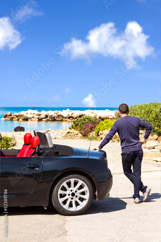 Man With Sport Car On The Beach