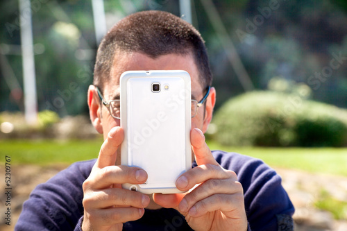 Man Taking Pictures With Smartphone