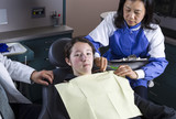 Young girl not thrilled at Dentist Office poster