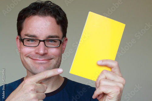 Man with glasses directing attention to an advertisement