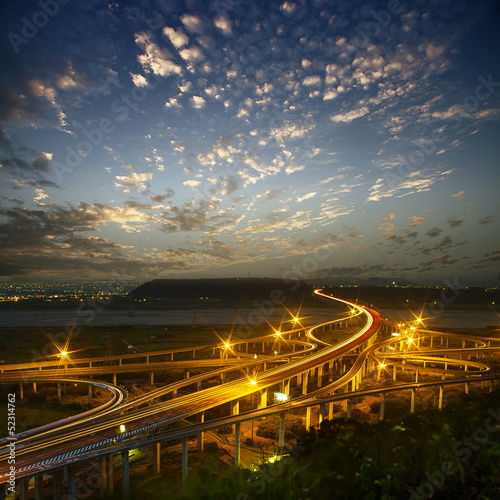 Highway in night with cars light in modern city in Taiwan, Asia.