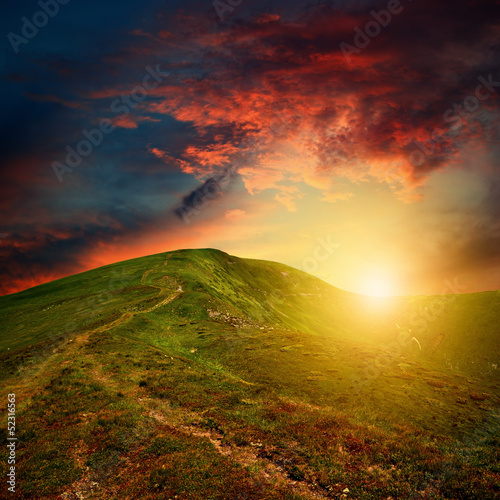 amazing mountain sunset with red clouds - 52316563