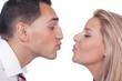Man and woman preparing to kiss