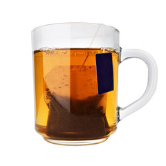glass cup of tea with packet