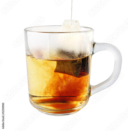hot tea in glass mug with packet