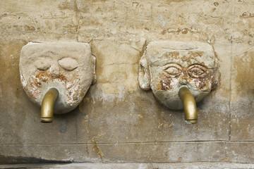Human head fountain, ancient stone fountain