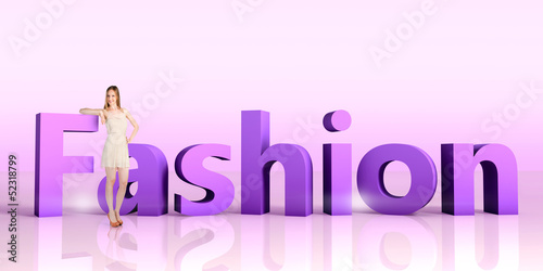 Young woman standing next to a word FASHION