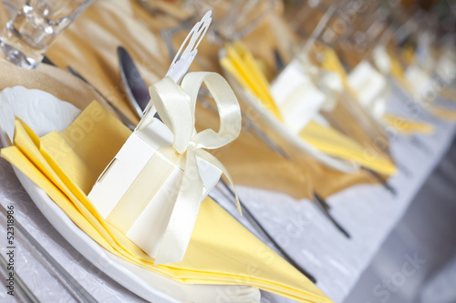 Wedding table cutlery and gift box on plate background concept