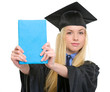 Young woman in graduation gown showing book
