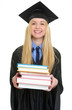 Happy young woman in graduation gown giving books