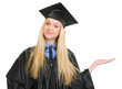Woman in graduation gown presenting something on empty palm