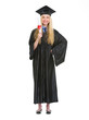 Full length portrait of woman in graduation gown showing diploma
