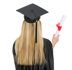 Woman in graduation gown with diploma. rear view