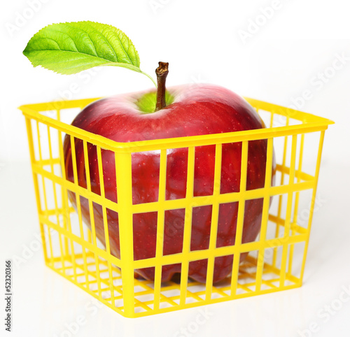 Red apple in shopping cart.