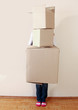 Woman holding stack of boxes