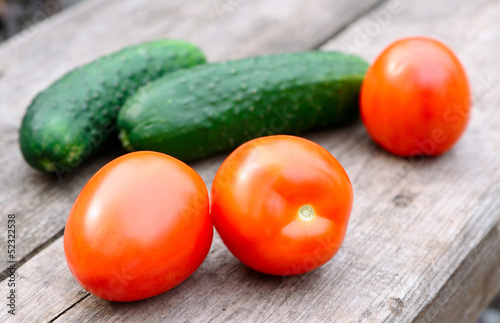 Raw tomatoes and cucumbers